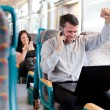 Stock Photo: Happy businessman receiving good news on a train. selective focu