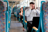 Tired businessman under a lot of stress on the train — Stock Photo