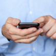 Close up view of a businessman using a smartphone — Stock Photo