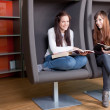 Young women reading books in library. Selective focus. - Stock Photo