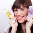 Joyful young woman with her hands full of Euros — Stock Photo