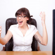 Young businesswoman screaming in rage after receiving bad news o — Stock Photo