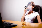 Young businesswoman chilling in her office, smoking a cigar and — Stock Photo