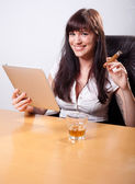 Young businesswoman relaxing in her office, using tablet compute — Stock Photo