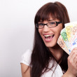 Ecstatic young woman with her hands full of money — Stock Photo