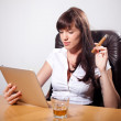 Stockfoto: Young businesswoman enjoying her time in the office