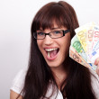 Ecstatic young womwith her hands full of money — Stock Photo #8962657