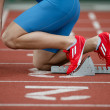 Stock Photo: Detailed view of sprinter in starting blocks