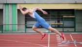 Professional sprinter's explosive start on the running track — Stock Photo