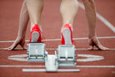 Detailed view of a sprinter wearing sprinting shoes with spikes, — Stock Photo