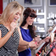 Cheerful women buying cosmetics in a beauty store — Stock Photo