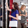 Women buying cosmetics in a beauty store — Stock Photo #9813989