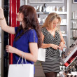 Women buying cosmetics in a beauty store — Stock Photo