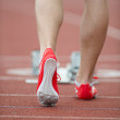Professional sprinter walking towards the starting line and star — Stock Photo