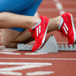 Detailed view of a sprinter in the starting blocks — Stock Photo #9969330