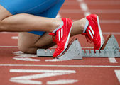 Detailed view of a sprinter in the starting blocks — Stock Photo