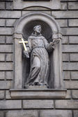 Sculpture of a saint in architecture in Prague — Stock Photo