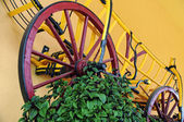 Old wooden wagon on the wall as decoration — Stock Photo