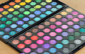 Makeup colorful eyeshadow palettes as background — Stockfoto