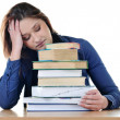 Student sleeping over books at the table — Stock Photo