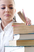 Leafs young student in the dictionary stack of books — Stock Photo