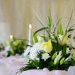 Bouquet of flowers with candles to set table - banquet — Stock Photo #9929117