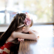 Litlle girl sitting at a table in restaurant — Stock Photo