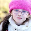 A portrait of little girl wearing pink cap — Stock Photo #7963374