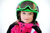 Little child girl in ski helmet and goggles — Stock Photo
