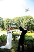 Bride and groom with pigeons at the wedding walk — Stock Photo