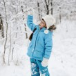 Adorable little girl in snow winter forest — Stock Photo #8465961