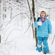 Adorable little girl in snow winter forest — Stock Photo #8465999