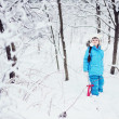 Adorable little girl in snow winter forest — Stock Photo