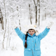 Adorable little girl in snow winter forest — Stock Photo #8466008