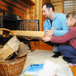 Father and daughter putting wood into fireplace — Stock Photo #8483266