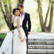 Bride and groom posing outdoors on wedding day — Stock Photo #8590213