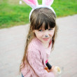 Portrait of cute little girl with bunny ears — Stock Photo