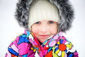 Portrait of toddler girl in colorful snowsuit — Stock fotografie