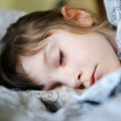 Closeup portrait of sleeping cute little girl - Stock Photo