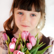 Portrait of child girl with tulips — Stock Photo