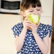 Adorable child girl eating apple at home — Stock Photo #9458187