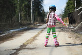 Sporty child girl on roller skates — Stock Photo