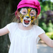 Cute little girl with painted face — Stock Photo #9698161