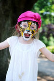Cute little girl with painted face — Stock Photo