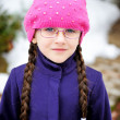 Portrait of child girl with pigtail in pink barret — Stock Photo #9979514