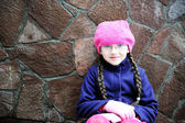 Portrait of child girl with pigtail in pink barret — Stock Photo