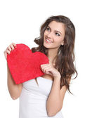 Young brunette holding a big love sign — Stock Photo