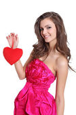Happy brunette holding a love sign — Stock Photo