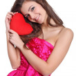 Romantic girl holding a love sign — Stock Photo