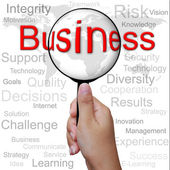 Negócios, palavra na lupa, fundo de negócios — Foto Stock